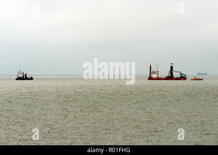 Capall Mara a self-propelled platform working a electricity cable laying to an offshore wind farm, Bawdsey, Suffolk, UK. - Stock Image