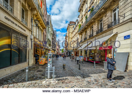 Shoppers enjoy a sunny day in the medieval old town of Rouen France, in the Normandy region - Stock Image