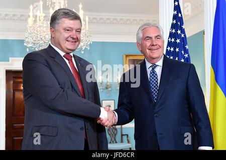 U.S. Secretary of State Rex Tillerson and Ukrainian President Petro Poroshenko shake hands before their bilateral - Stock Image