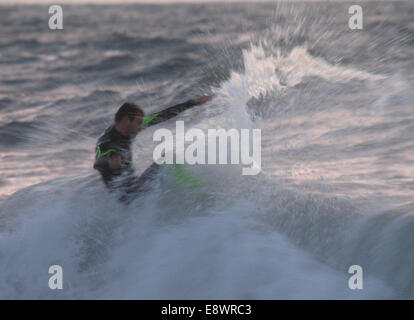 Motion blur image of a surfer, Bude, Cornwall, UK - Stock Image