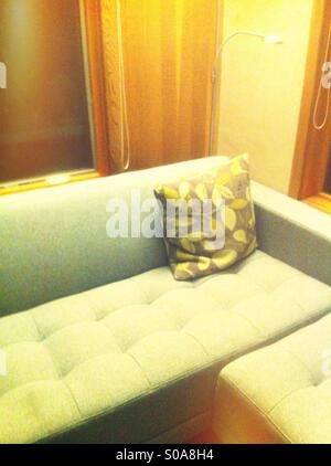 Couch and pillow - Stock Image
