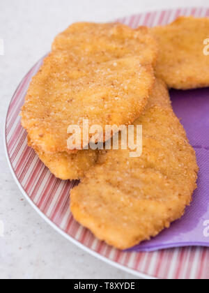 Golden delicious Wiener steak on plate close up - Stock Image