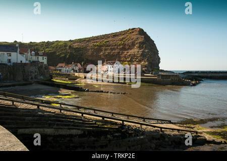Rocky cliff headland Yorkshire coast UK - Stock Image