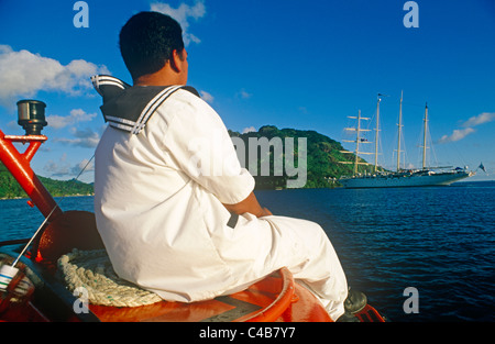 French Polynesia, Society Islands, Leeward Islands, Huahine Island (aka Mata'irea). A seaman returns to the - Stock Image