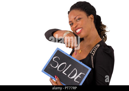 Portrait of a young business woman smiling holding a slate on which it is written reduction - Stock Image