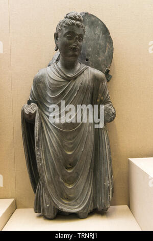 Grey Schist Standing Buddha. 2nd-3rd Century. Central Gandhara. Department of Archaeology and Museums, Pakistan - Stock Image