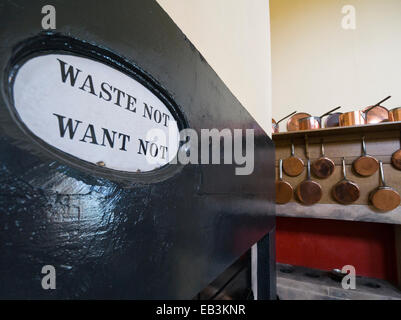 Waste not want not sign in a kitchen - Stock Image