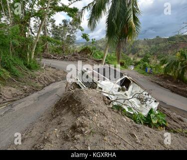 A vehicle is stuck in debris after a landslide in the aftermath of Hurricane Maria November 2, 2017 in Anasco, Puerto - Stock Image