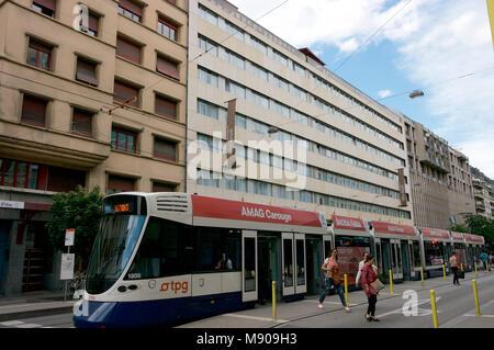 Hotel Royal Geneva Switzerland and city transit electric tram - Stock Image