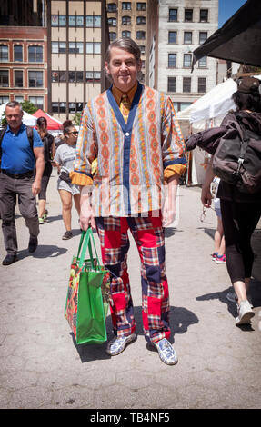 Posed portrait of a shopper in Union Square Park with his own individual personal fashion Style. In Manhattan, New York City. - Stock Image