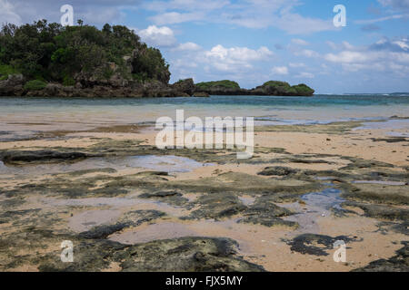 Beach By Sea Against Cloudy Sky - Stock Image