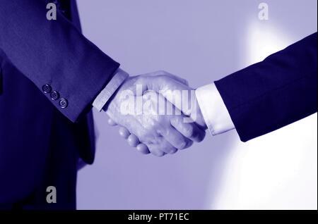 Handshake between two businessmen - Stock Image