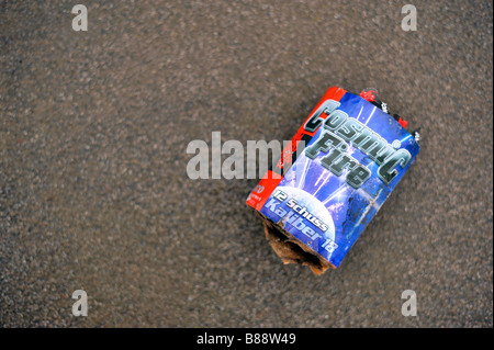 cosmic fire discarded firework street after the party celebration over - Stock Image