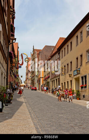 The old street Obere Schmiedgasse in medieval town Rothenburg ob der Tauber, Franconia, Bavaria, Germany, on a sunny summer day - Stock Image