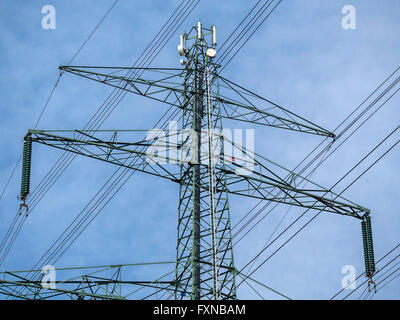 High voltage power pole, mobile, wireless transmission equipment on top, Hamburg, Germany - Stock Image