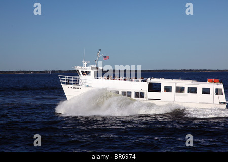 The Stranger ferry plowing through the waters of the Great South Bay between Fire Island and Bay Shore, NY - Stock Image