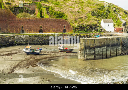 Porthgain Harbour on the north Pembrokeshire coast with the tide coming in. - Stock Image