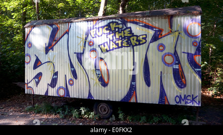 Graffiti on a wall saying fuck the haters football anon anonymous clour statement artist - Stock Image
