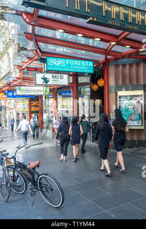 Melbourne city centre with shops and stores, ladies walk along the pavement,Melbourne,Victoria - Stock Image
