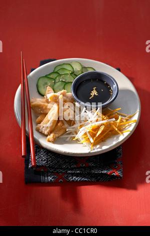 Salmon Snacks, Raw Vegetables and Soja Sauce - Stock Image