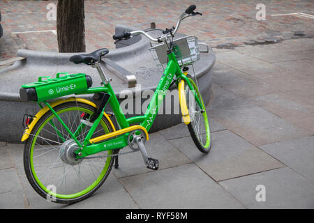 A Lime dockless GPS-tracked electric bike or e-bike parked in Soho, London. - Stock Image