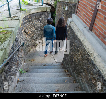 Paris, France, Female Tourists Walking DOwn Stairs at French Cemetery, 'Pere Lachaise'. couple Rear - Stock Image