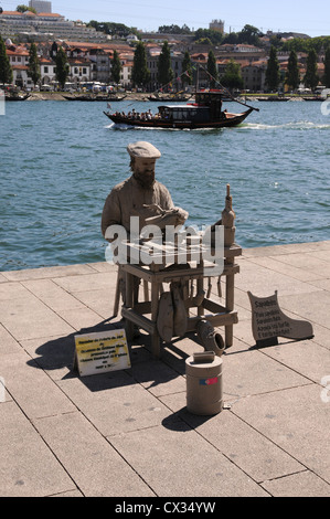 Human statue on the banks of the River Douro, Oporto, Portugal - Stock Image