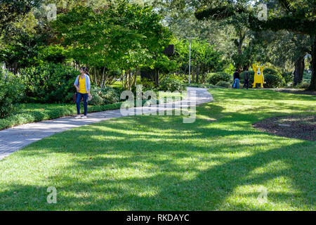 Visitors on park grounds of New Orleans Sculpture Garden New Orleans, Louisiana, United States of America, USA - Stock Image