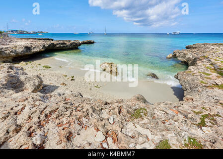 Rocky coastline in Cayman Islands with clear turquoise water. - Stock Image