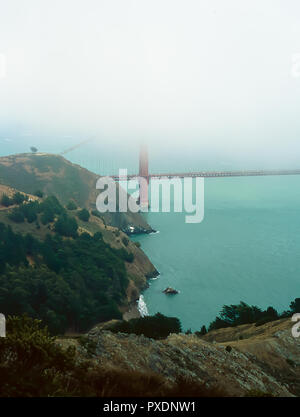 The Golden Gate Bridge in the fog as taken from the Marin Headlands, California - Stock Image