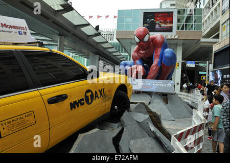 Spider-Man and New York Yellow cab taxi promotion in Kowloon, Hong Kong, China - Stock Image