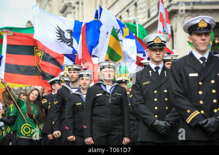 London, UK, 17th Mar 2019. Members of the L.E. James Joyce Irish Naval Service with colourful flags. Now in its 17th year, the parade attracts more than 50,000 people for a colourful procession of Irish marching bands from the UK, US and Ireland, energetic dance troupes and spectacular pageantry. Credit: Imageplotter/Alamy Live News - Stock Image