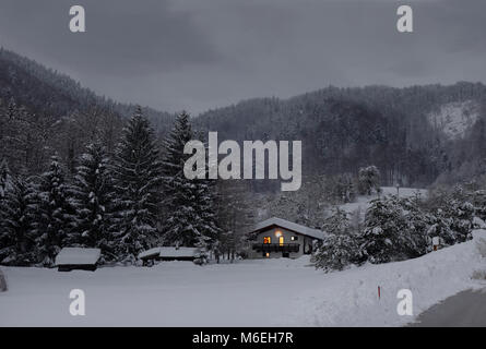 Snow covered landscape with a holiday house in early dusk. Savinjska region ; Stajerska (Steiermark) Slovenia - Stock Image