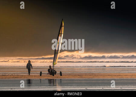 Evening light over Fistral as a Sand yacht sails across the beach. - Stock Image