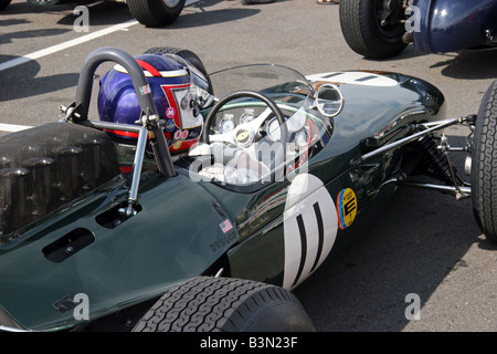 green racing car on in the pit at start of race - Stock Image
