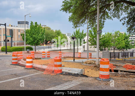 Concrete city sidewalk under construction for repair in Montgomery Alabama, USA. - Stock Image