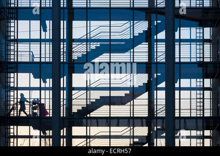 SILHOUETTE OF A CHARWOMAN, STAIRCASE, OFFICE BLOCK, STUTTGART, BADEN-WURTTEMBERG, GERMANY - Stock Image