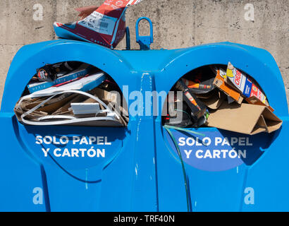 Solo papel y carton (only paper and carton) recycling container for public use in street in Spain. - Stock Image