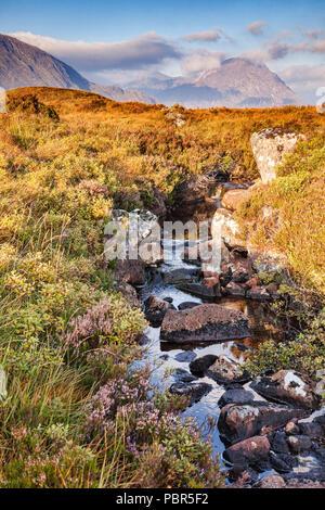 A small stream in Glencoe, Lochaber, Highlands, Scotland, UK. - Stock Image