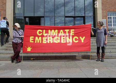 Activists from the Climate Change group Extinction Rebellion hold a banner saying ÒClimate EmergencyÓ during a demo outside Derby City Council house on 22/05/2019 - Stock Image