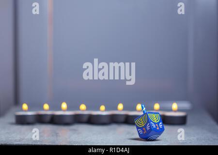 The Defocused lights of Jewish holiday Hanukkah. - Stock Image