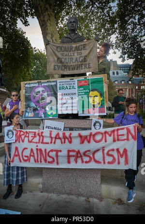 London, UK, 29th September 2018. Parliament Square London  Brazilian Civil Rights Protest in London 29th September.    Brazilians in london protest against far right wing  political candidate Jair bolsanaro and his conservative policies.  Protest is led by women by the statue of suffragist Millicent Fawsett Credit: marc zakian/Alamy Live News - Stock Image