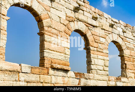VERONA, ITALY - SEPTEMBER 2018: Walls and window arches of the Verona Arena, which is a historic Roman amphitheatre in the city centre. - Stock Image
