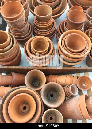 Selection of vintage terracotta gardening pots for sale in a market stall, England - Stock Image