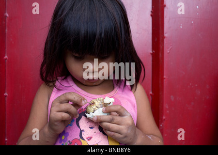 A Filipino enjoys a balut, or cooked fertilized duck egg, in Oriental Mindoro, Philippines. - Stock Image
