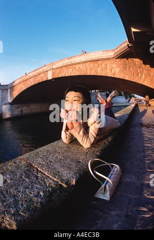 Young Japanese woman at La Seine Paris France - Stock Image