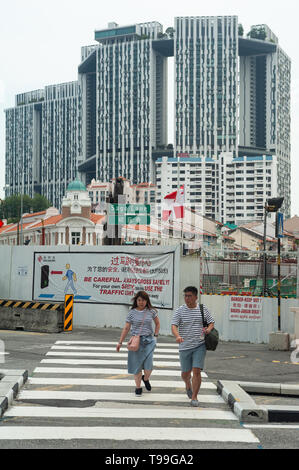 12.04.2019, Singapore, , Singapore - Pedestrians in Chinatown with The Pinnacle at Duxton in the background. 0SL190412D001CAROEX.JPG [MODEL RELEASE: N - Stock Image