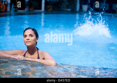 A couple in a swimming pool. - Stock Image