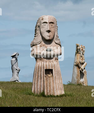 St Diboan granite sculpture at the Valley of the Saints, Quenequillec, Brittany, France. - Stock Image