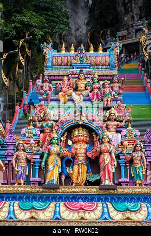 Batu Caves, Hindu Deities above Entrance to Steps leading to Caves, Selangor, Malaysia. - Stock Image